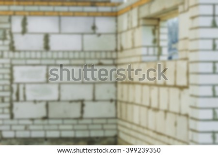 abstract blurred defocused background. Unfinished european house of brick, still under construction. Building concept - stock photo