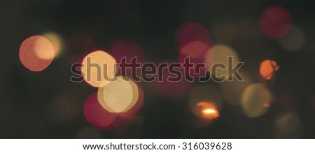 Abstract blurred defocused city night lights in orange and red colors bokeh - stock photo