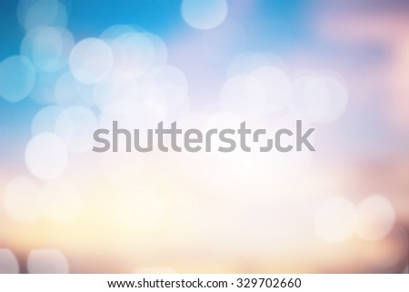 abstract blurred dreamy imagination tropical background:backdrop dusk sky with bubble circle light motion movement in pastel tone color.blurry vintage effect bokeh glowing/sparkle xmas festive image - stock photo