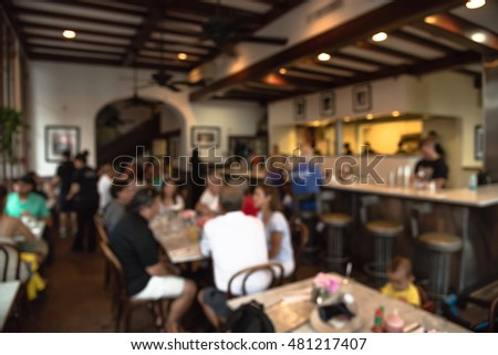 Abstract blurred French restaurant interior in French Quarter of New Orleans, Louisiana, US with people enjoying cafe, Creole cuisine and Cajun food. New Orleans is deeply tied to French food culture