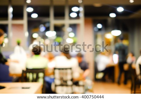 abstract blurred group of asian family meeting in the restaurant background:blurry of caucasian people having funny party after working concept:blur lifestyle manner conceptual. - stock photo