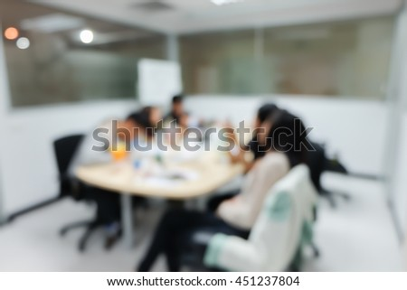abstract blurred group of asian student reading books for test in silence room at library concept.blur university educator practice homework for examination:blur people in classroom:blurry education. - stock photo