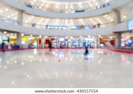 abstract blurred ice skating rink in department store. - stock photo