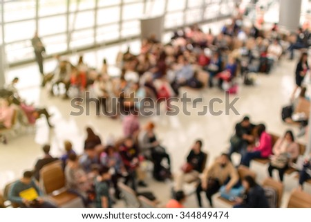 Abstract blurred image of passenger in the airport waiting at the gate - stock photo