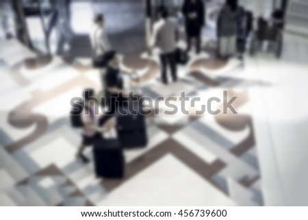 Abstract blurred image of people walking in the subway station for background. - stock photo
