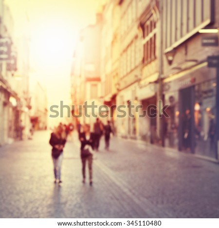 Abstract blurred image of people walking on the street. - stock photo