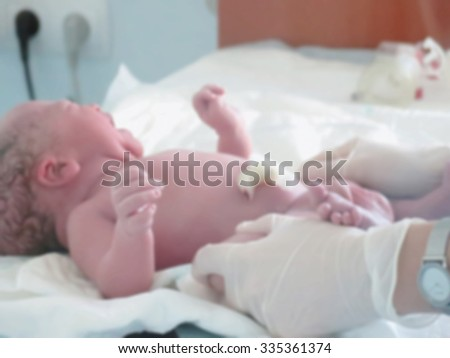 Abstract blurred image of the interior box for newborns. Pediatricians and the newborn child with a bokeh background. Fine background for projects - stock photo