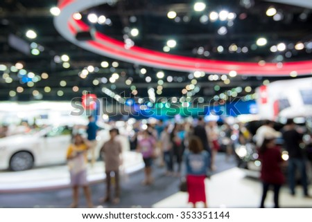 Abstract blurred image people in cars exhibition show   - stock photo