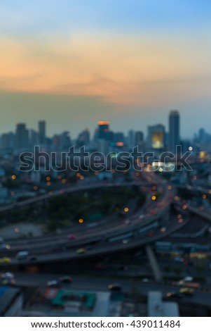 Abstract blurred lights, city downtown background and highway interchanged after sunset - stock photo