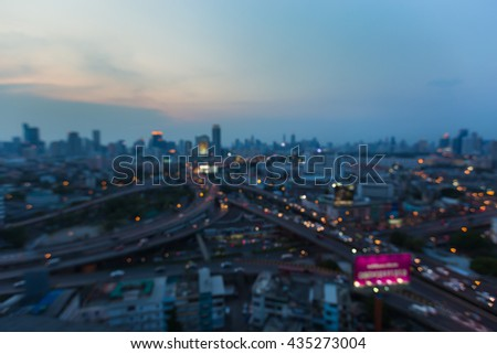 Abstract blurred lights intersection highway and city downtown background - stock photo