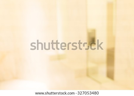 Abstract blurred men toilet in restaurant with light bokeh - stock photo