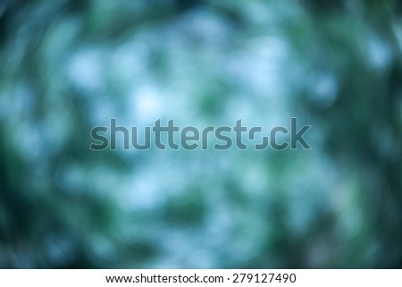 Abstract blurred nature background. Blur green and blue leaves with bokeh - stock photo