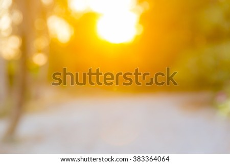 Abstract blurred nature background with bright sunlight - stock photo