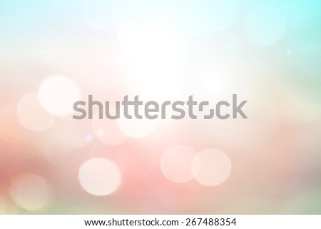 Abstract blurred nature textured background: pink and blue patterns. Sandy beach backdrop with turquoise water and bright sun light. Summer holidays concept. - stock photo