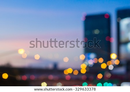 Abstract blurred night city background with circle light:blur of cityscape in sunset hour wallpaper concept:blurry night urban backdrop.blurry construction building landscape.sunset/sunrise hour - stock photo