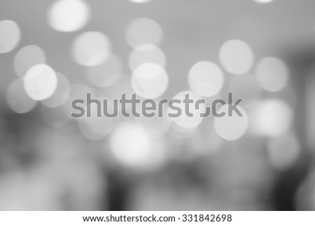 abstract blurred of bokeh light in black and white backgrounds:blurry circle shiny light in gray scale tone colour.image display for design,decorate or etc. - stock photo