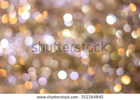 abstract blurred of golden and silver glittering shine bulbs lights background:blur of Christmas wallpaper decorations concept.xmas holiday festival backdrop:sparkle circle lit celebrations display. - stock photo