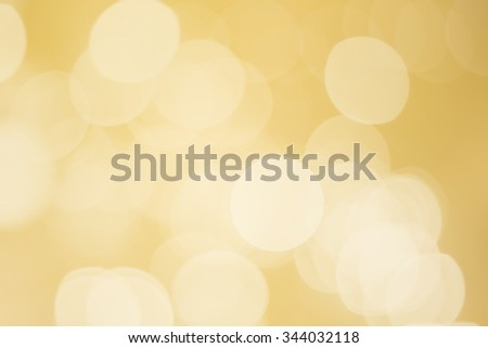 abstract blurred of golden bulbs lights backgrounds:blur of circle lights backdrop wallpaper for design and decorate.Christmas background concept.happy new year card banner template.