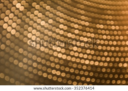 abstract blurred of golden color backgrounds with circle lights.
