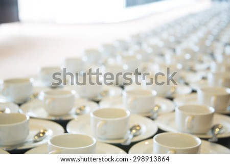 Abstract blurred of many rows of coffee or tea cups for background. - stock photo