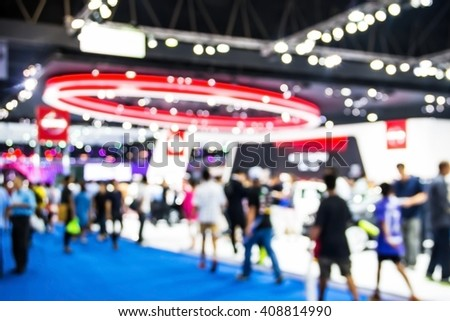 abstract blurred of motor  show and  technology exhibition in arena hall. - stock photo
