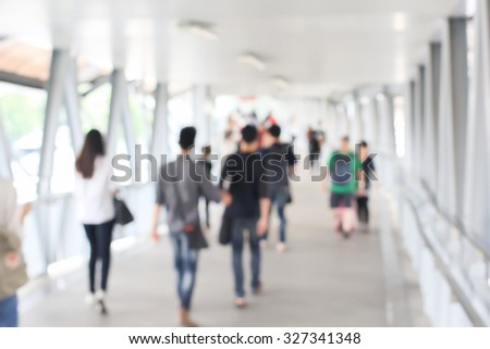 abstract blurred of movement crowd people walking to the airport gate for travel or business:blur of indoor architecture concept:blurry people walking crowded conception.traveler concept. - stock photo