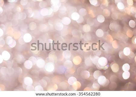 abstract blurred of sepia vintage and bronze glittering shine bulb lights background:blur of Christmas day wallpaper decoration concept.xmas design festival backdrop:sparkle circle celebration display - stock photo