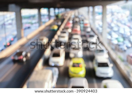 abstract blurred of traffic in the morning backgrounds : blur of vehicles cars,saloon,bus,motorcycle in the road :out of focus concept.image with film effect.blurry city backdrop.