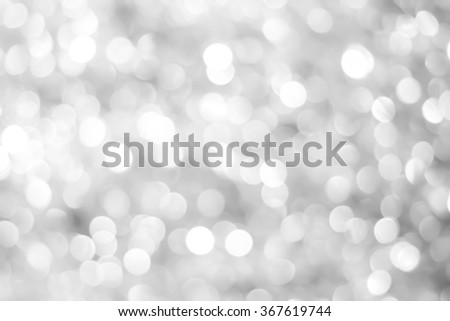 abstract blurred of white/silver/bronze glittering shine bulb lights background:blur of Christmas day wallpaper decoration concept.xmas design festival backdrop:sparkle circle celebration display.  - stock photo