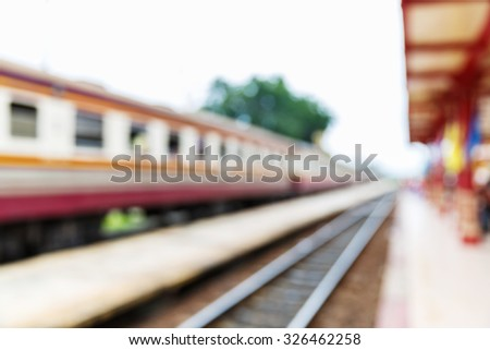 Abstract blurred old style train station, rural travelling concept - stock photo
