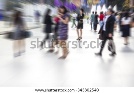 Abstract blurred people are walking in the city - stock photo