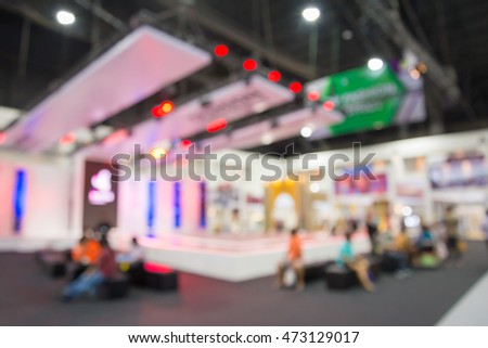 Abstract blurred people in exhibition hall event background usage