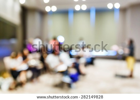 Abstract blurred people in press conference room, business concept - stock photo