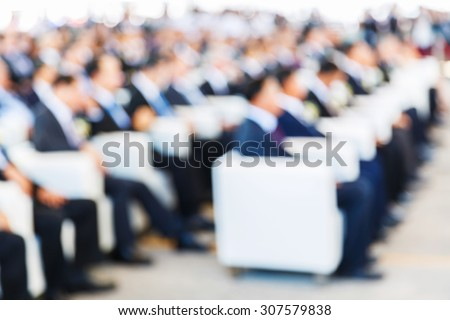 Abstract blurred people in press conference room, business concept, official new product launches