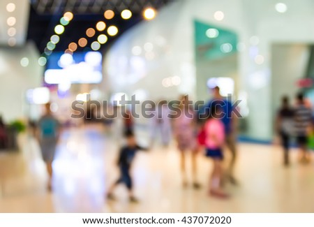 abstract blurred people rushing in the lobby in the airport. - stock photo