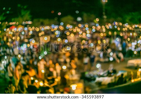 Abstract blurred people shopping at market fair in night day
