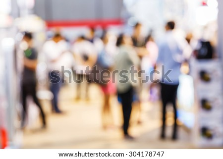 Abstract blurred people shopping in department store, urban lifestyle concept