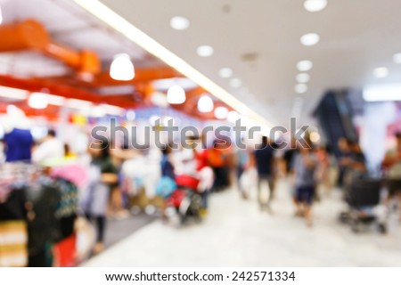 Abstract blurred people walking in shopping center - stock photo