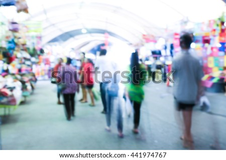 abstract  blurred people walking in shopping centre