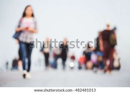 abstract blurred people walking on the street