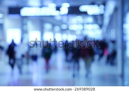 Abstract blurred people walking through the corridor - stock photo