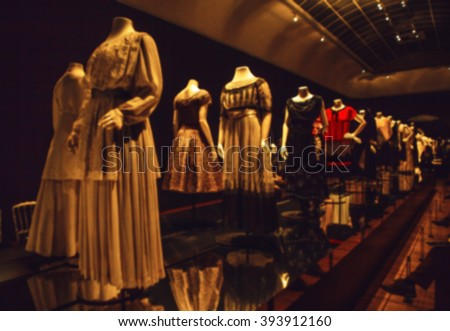 Abstract blurred photo of dummies in ancient fashionable dresses as background.
