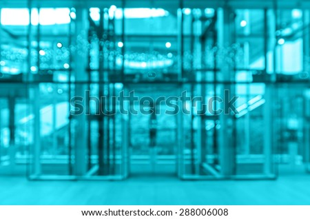 Abstract blurred photo of glass elevation with bokeh background - stock photo