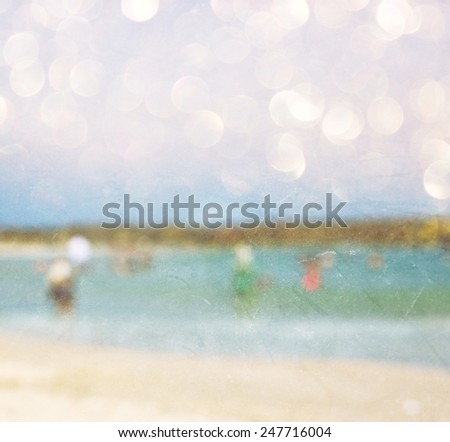 abstract blurred photo of people at the beach, image is blurred ready for typography - stock photo