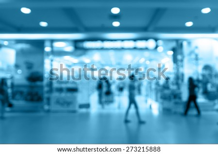 Abstract blurred photo of store with people in department store bokeh background