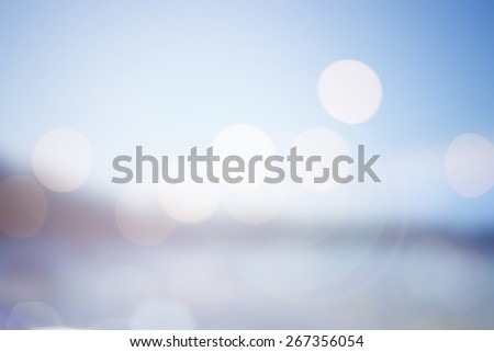 abstract blurred seaboard with bokeh sun flare lights background:blur sand/beach tropical hot season holiday backdrop concept in vintage/instagram color tone effect ideal:blurry shores/coastline dream - stock photo