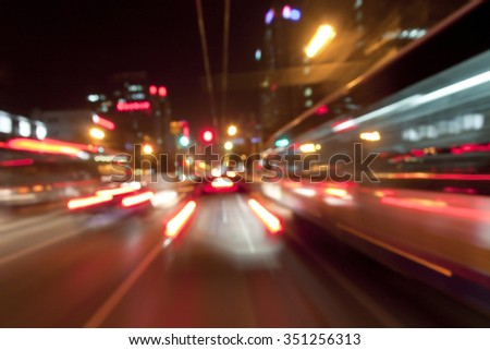 Abstract blurred speed motion in urban highway road tunnel, moving toward the light