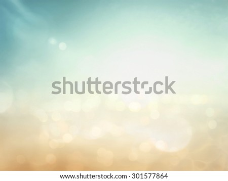 Abstract blurred sunrise over city background with circle bokeh light. Beautiful light of hope from heaven concept. Orange yellow green blue colors patterns. Blur backgrounds concept. - stock photo