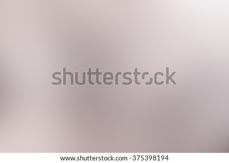 abstract blurred tan color tone backdrop.blurry of surface metallic background wallpaper concept:blurry shining light display concept:sparkle glitter soft and smooth of monochrome for decorate,design - stock photo