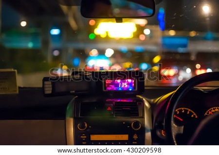 Abstract blurred taxi driver view on the road at night.